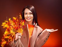 Woman holding  orange leaves. Stock Photo