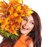 Woman holding orange leaves. Isolated stock photo