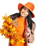 Woman holding orange leaves. Woman wearing overcoat holding orange leaves stock images