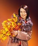 Woman holding  orange leaves. Royalty Free Stock Photos