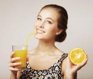 Woman holding orange and orange juice stock photo