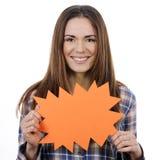 Woman holding orange panel Stock Images