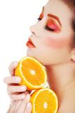 Woman holding orange Royalty Free Stock Image