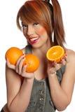 Woman holding oranges Stock Photos