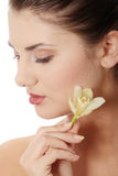 Woman holding orchid flower Stock Photography