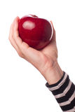 Woman holding organic red delicious apple Stock Photo