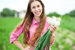 Woman holding organic spring onions Royalty Free Stock Photos