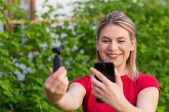 Woman holding osmo camera stock images