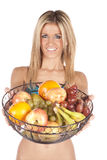 Woman holding out fruit basket Stock Photo