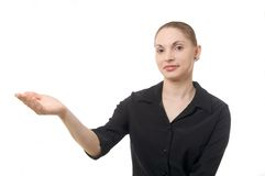 Woman Holding Out Hand. An attractive woman in a black blouse holding out her right hand. All on a white background stock photos