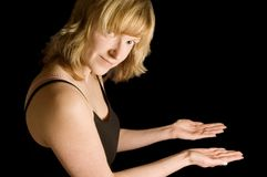 Woman holding out hands Royalty Free Stock Photo