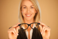 Woman Holding Out Her Spectacles Stock Image