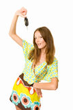Woman holding out the keys of her car. Woman holding out the keys to her car Royalty Free Stock Photo