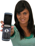 Woman holding out mobile phone Royalty Free Stock Images