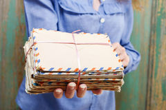 Woman holding package of vintage letters Royalty Free Stock Image