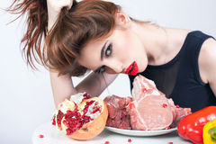 Woman holding packaged meat at the supermarket Royalty Free Stock Image