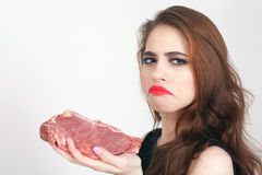Woman holding packaged meat at the supermarket. Image of woman holding packaged meat at the supermarket. Healthy eating. Meat recipes, expiration date, shelf Stock Images