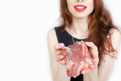 Woman holding packaged meat at the supermarket. Image of woman holding packaged meat at the supermarket. Healthy eating. Meat recipes, expiration date, shelf Royalty Free Stock Photos