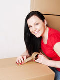 Woman holding and packing cardboard boxes Stock Image