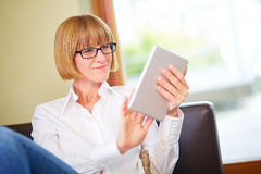Woman holding pad at home Stock Photo