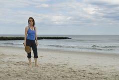 Woman holding paddleball racket on beach royalty free stock image