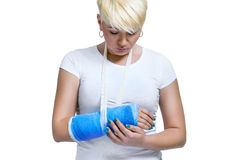 Woman holding painful broken arm Stock Images