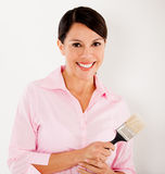 Woman holding a paint brush Royalty Free Stock Image