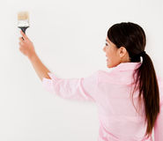 Woman holding a paint brush Royalty Free Stock Photos
