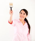 Woman holding a paint brush Stock Photos