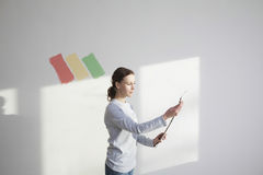 Woman Holding Paint Color Swatches. Young women holding paint color swatches in new apartment Royalty Free Stock Photos