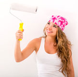 Woman holding a paint roller Royalty Free Stock Photography