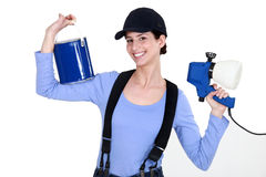 Woman holding paint sprayer Royalty Free Stock Image