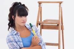 Woman holding paintbrush Royalty Free Stock Image