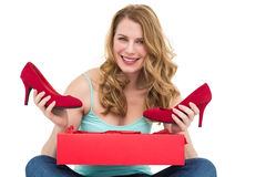 Woman holding pair of shoes discovered into the box Royalty Free Stock Photo
