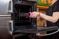 Woman holding pan  near oven Stock Photos