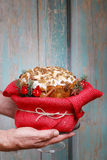 Woman holding panettone wrapped as a christmas gift Stock Image