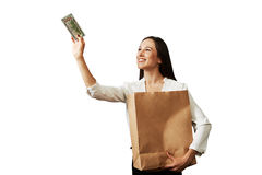 Woman holding paper bag and banknote Stock Photos