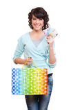 Woman holding paper bag and money Stock Photography