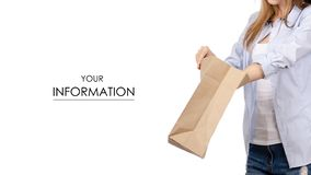 Woman holding a paper bag package food take and go pattern. On a white background. Isolation stock photo