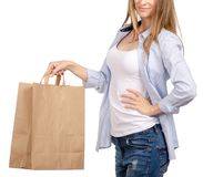 Woman holding a paper bag shopping beauty. On a white background. Isolation stock photo