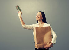 Woman holding paper bag Stock Images