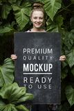 Woman holding paper board design space royalty free stock photography