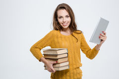 Woman holding paper books and tablet computer Royalty Free Stock Photography
