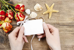 Woman holding paper card in beautiful hands Royalty Free Stock Photo