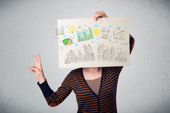 Woman holding a paper with charts and cityscape in front of her Royalty Free Stock Photo