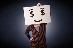 Woman holding paper with greedy emotion Royalty Free Stock Images