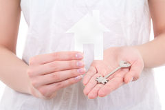 Woman holding paper house and key Stock Photography