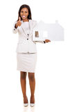 Woman holding paper house Stock Photo