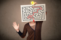 Woman holding a paper with a labyrinth on it in front of her head vector illustration