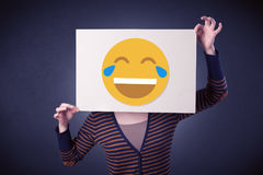 Woman holding paper with laughing emoticon Stock Photo